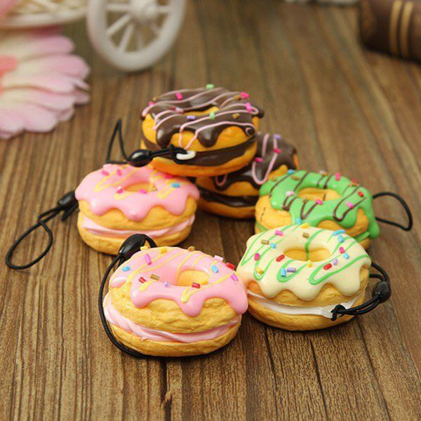 This adorable scented phone charm is bound to make your day a bit sweeter, starting at breakfast. Colors may vary.