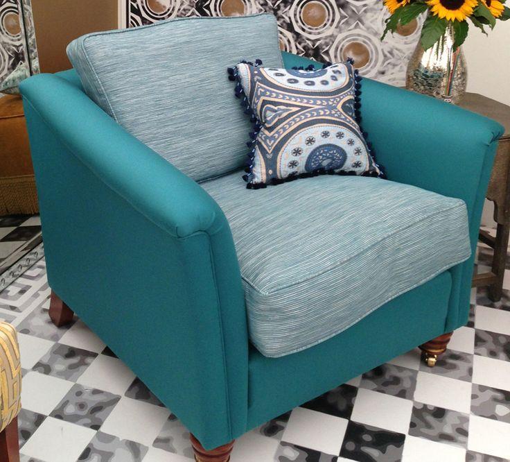 A vivid turquoise armchair.