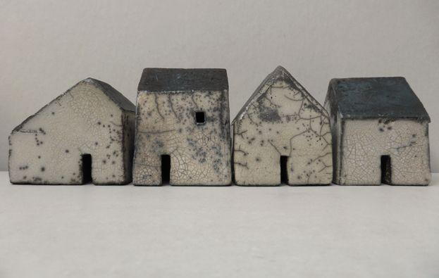 row of four raku houses by Rowena Brown