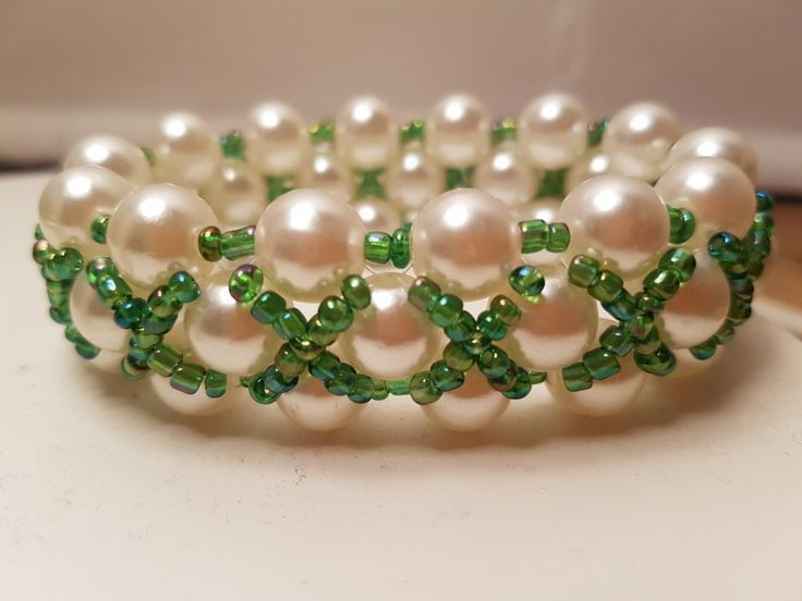 Pearl and green seed beads