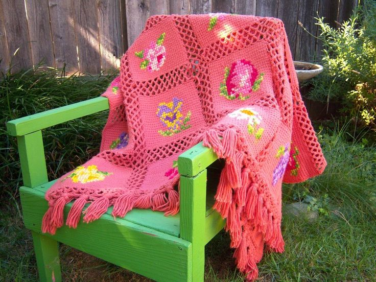 **RESERVED FOR MISSMARPLETOO**    This blanket is amazing. Individual knit squares, embroidered with flowers and fruit then chain crocheted together plus tassels. Sweetly unique. Approx 50 x 61 plus tassels (covers a double bed)  Soft coral pink yarn, a heavy worsted spin, most likely a synthetic. Blanket is nicely weighted. Some lightly loose yarn ends in embroidery, but designs are complete and lovely. No loose knit or crochet. BEAUTIFUL VINTAGE CONDITION    Questions? Please ask! :-)…