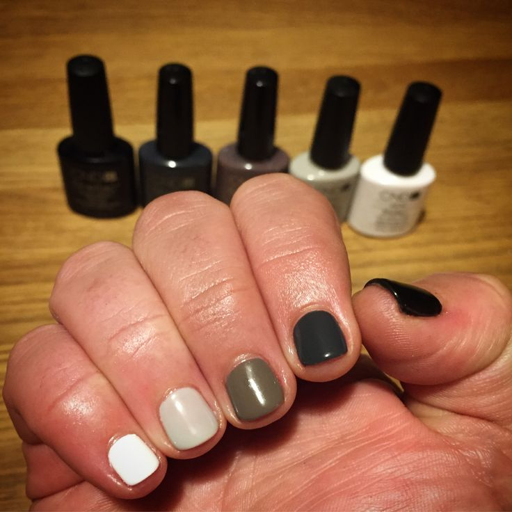 Black, grey and white ombré nails.