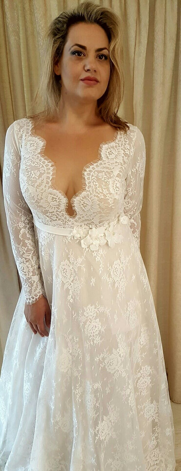 Plus size romantic French lace wedding gown with a deep v-neck and long sleeves. Sophia. Studio Levana. 2018