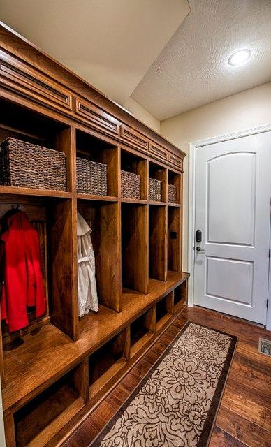 Love this mudroom. Individual spots for jackets, low shelves for shoes, maybe the top baskets for scarves, gloves and hats?