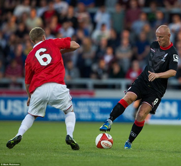 Keeping possession: Nicky Butt ensures Salford City's No. 6 isn't getting anywhere near th...