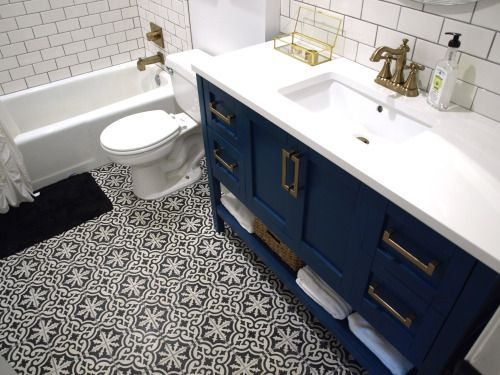 i love the simple tub revamped with beautiful fittngs and tilefloor and vanity are fabulous