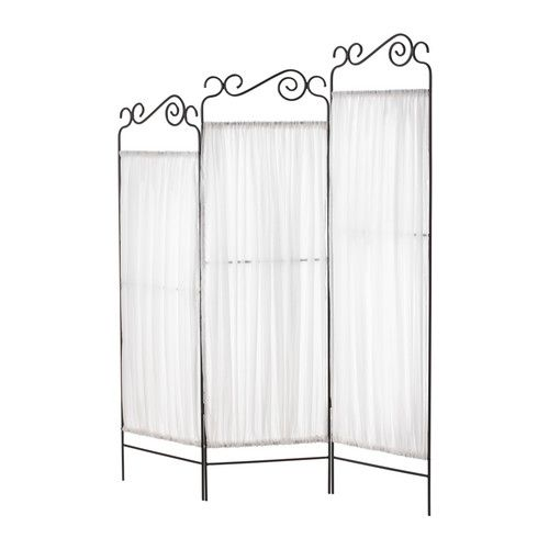 A room divider can help add privacy to a small space. Buy or make one yourself from curtains and a shower rod.