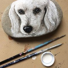 Lola ❤️ #dogportrait #dogpainting #poodle #frenchpoodle #rockart #paintedstones #paintedrocks #dogart #petportrait