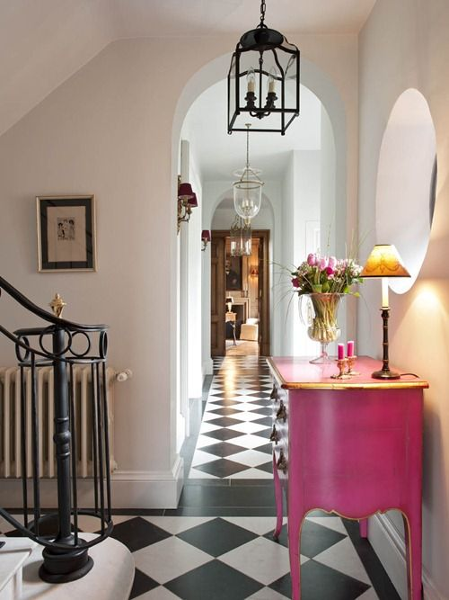 Pink chest looks great in a black and white foyer
