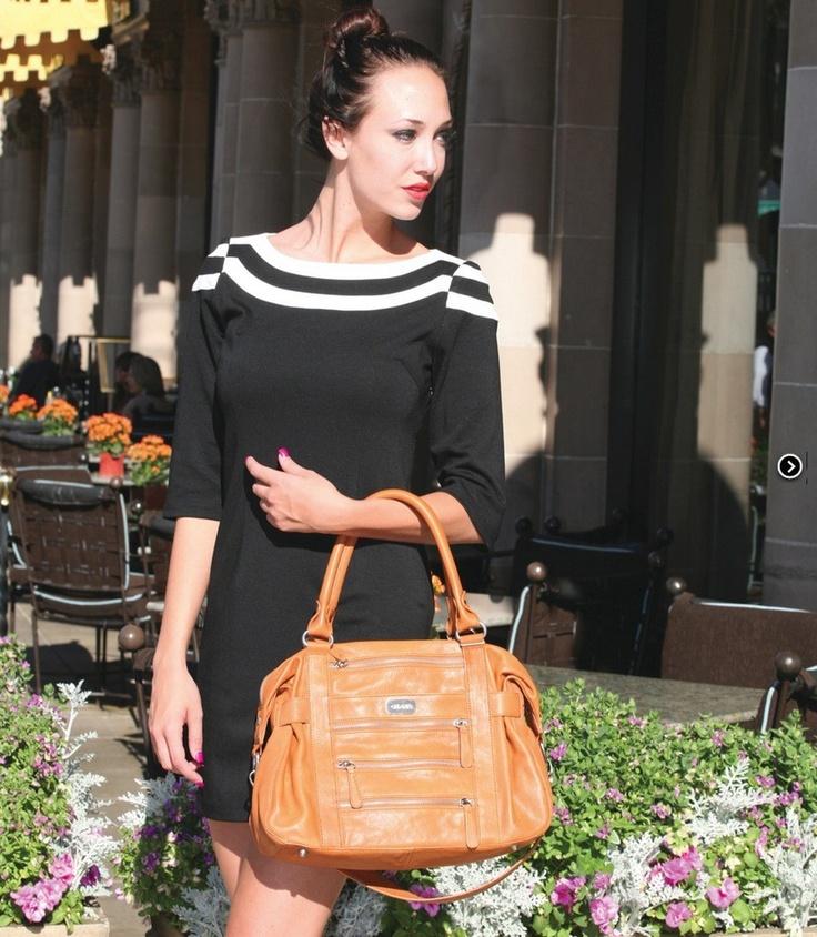 A tan handbag is a style staple  The Caroline