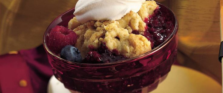 Make merry with a triple berry warm and cozy cobbler.  Made with frozen berries. Good, but cooking berries made them jelly-like.