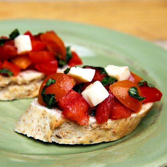 The Bold Yet Basic Bruschetta Recipe Everyone Will Want From You: Have a few handfuls of juicy ripe tomatoes from the garden and you're not sure what to do with them?