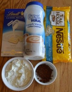 Instant White Hot Chocolate (2 tbsp / cup hot water): 4 oz. Lindt white chocolate bar, broken into pieces; 1 1/2 cups powdered milk; 2/3 cup white chocolate chips; 1/2 cup vanilla or French vanilla non-dairy creamer; 2 tsp. dutch cocoa (yes, it is dark cocoa); 1/4 tsp. salt