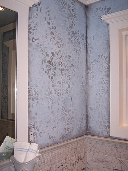 Washed damask faux wall painting.