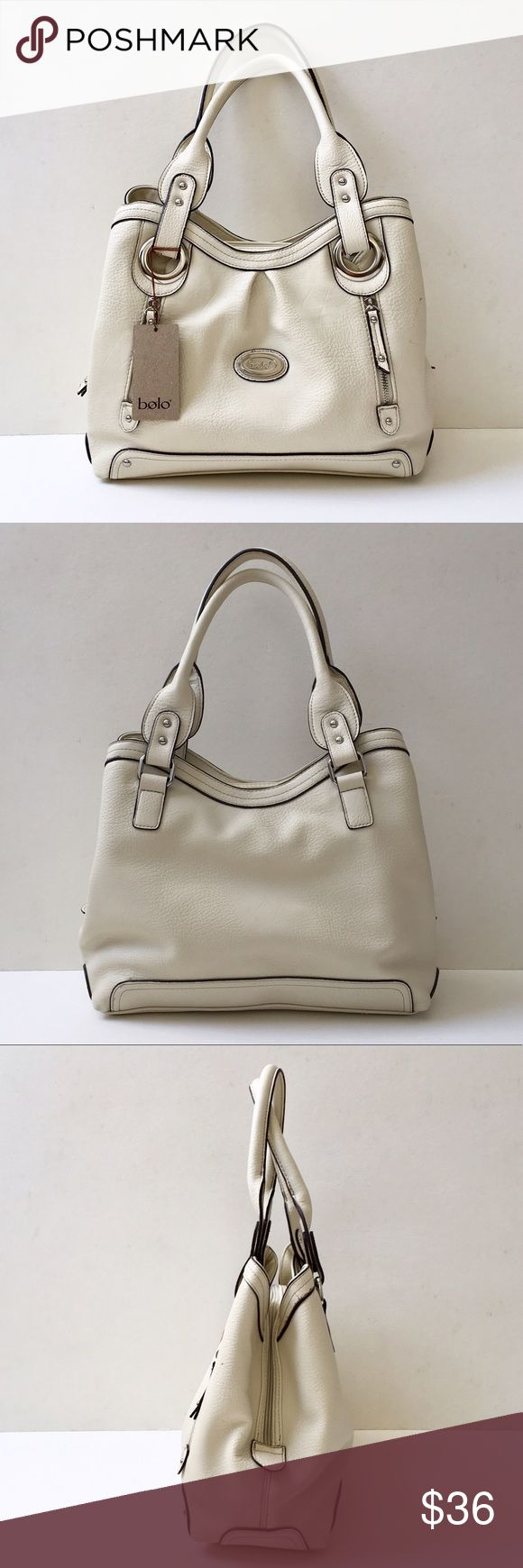 Bolo Pebble Textured Neutral Shoulder Bag, NWT Pleather. 19 inches long including straps. Body o  bag: 13 inches wide x 11 inches high x 5.5 inches deep. Three compartments. Center zip with two snap openings at sides. Three interior pockets at center compartment. Colors: exterior is bone with black accents, lined in camel colored fabric. Roomy, holds a lot. Great neutral bag. Issue: See last pic...scratch or transfer of color, mark, perfect other than that. NWT. Bolo Bags Shoulder Bags