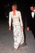 1988 – Diana chose a chic strapless evening gown and a matching bolero by Victor Edelstein for an evening event during a royal tour of France with Prince Charles.   Photo By Rex Features