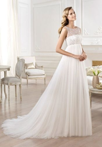 Soft tulle imperial dress. Silver and mother-of-pearl jewelled bodice with bateau neckline, Sabrina-style, and sheer off-the-shoulder layer. Pleated tulle skirt.