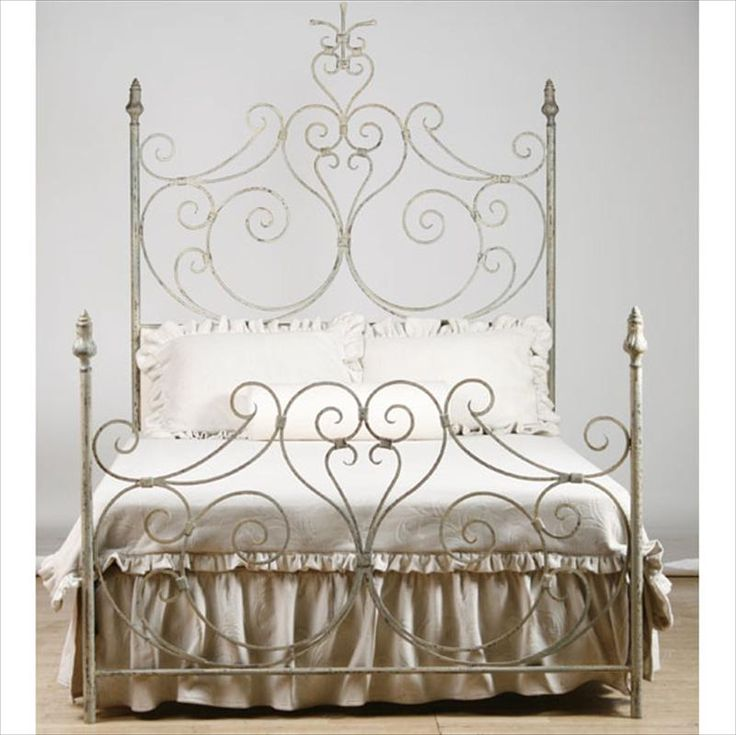 Farmhouse Iron Scroll Bed with Upholstered Headboard- I normally like a bed that looks like it can take a lot of ... rockin',... but this is pretty awesome.
