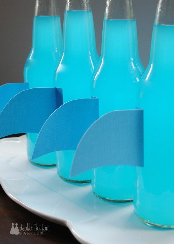 Turn scrapbooking cardstock in shark fins for your Shark party sodas
