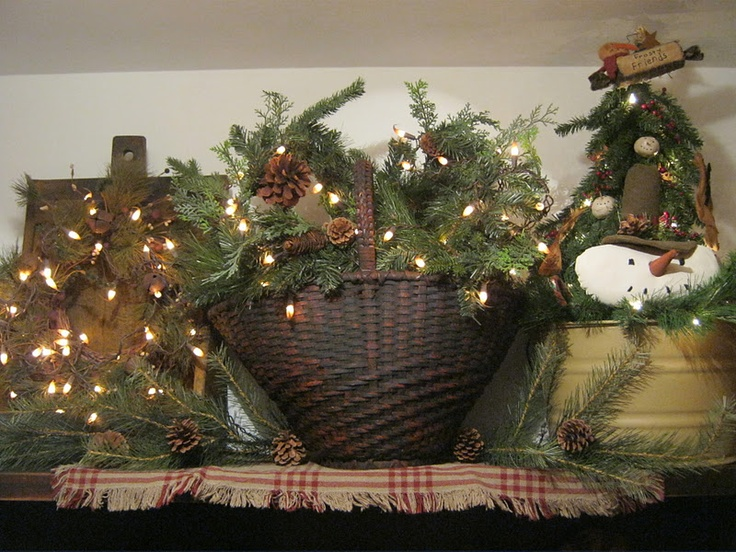 love the basket with lights and greenery