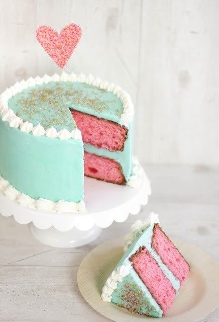 A pink and aqua cake with a pretty little heart is perfect for a tea party themed bridal shower or intimate wedding