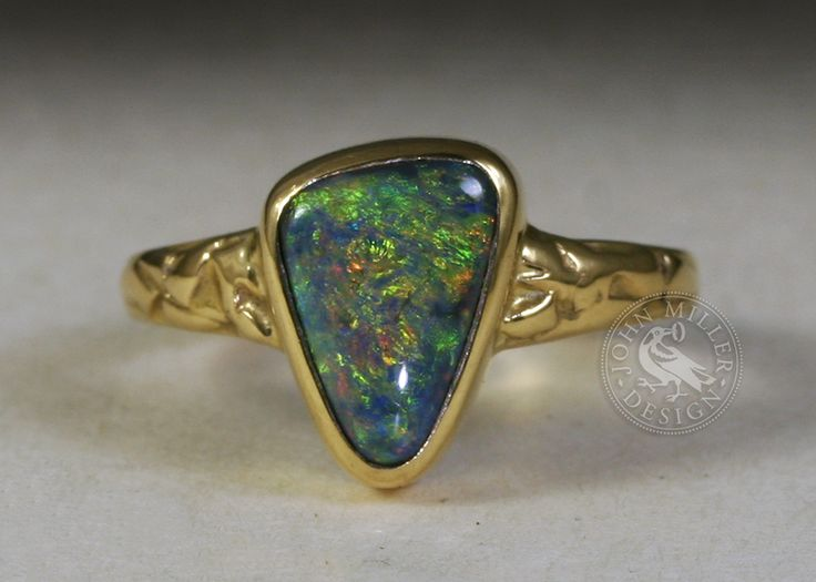 Solid Black 3.2ct Lightning Ridge opal in 18ct yellow gold with a fused band