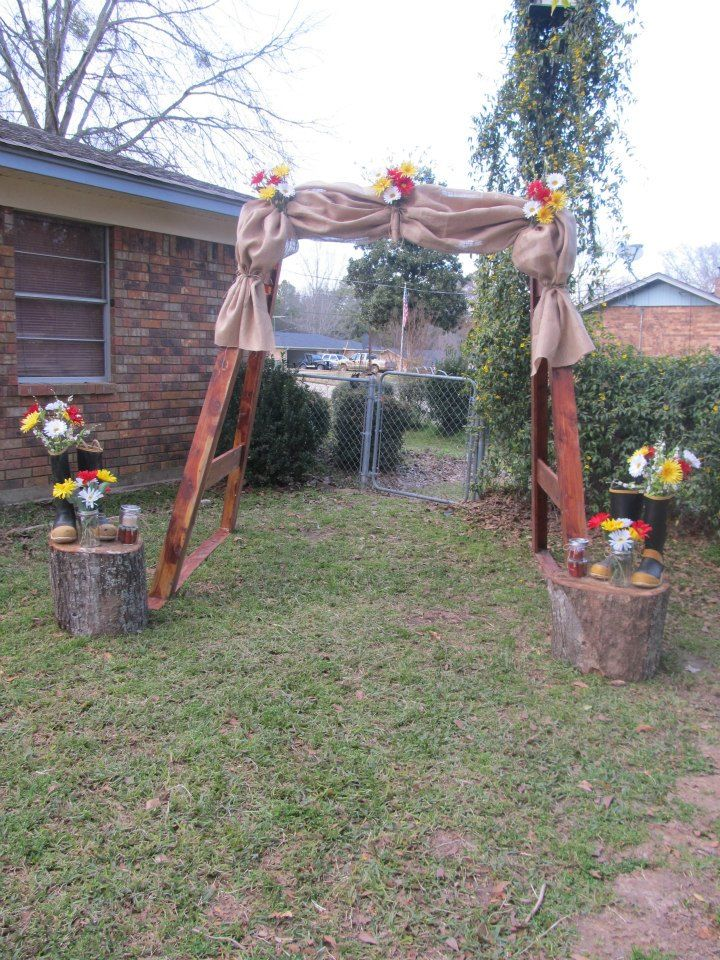 We used the cedar frame for the swing as our archway and placed stumps on either side w/firefighter boots w/flowers & mason jars filled w/flowers & empyt shot gun shells w/a candle in it.