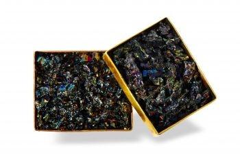 Striking carborundum stone, in modernistic handmade setting of brass.  http://mysfashion.com