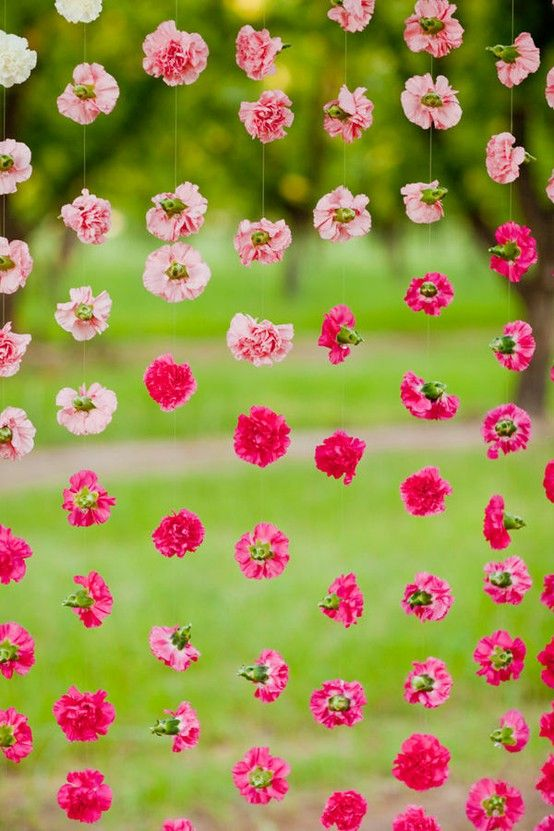flowers on fishing line (try paper flowers or other paper cut outs) - weddingsabeautiful