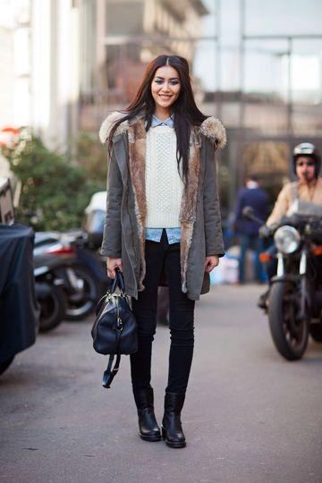 Parka Coat In Layered Outfit With Chambray Shirt and Cable Knit Jumper #parka #parkacoat #parkajacket #khakicoat #khakijacket #blackskinnies #blacktrousers #cableknitjumper #whitejumper #denimshirt #chambrayshirt #layering #fauxfur #fauxfurtrim #furtrim #furlined #fauxfurlined #dufflebag #blackdufflebag