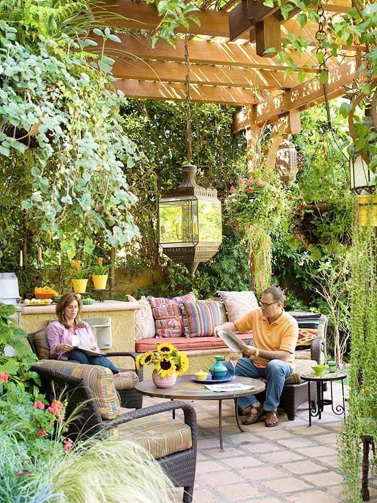 Patio space with solid floor, pergola 'roof', hanging lights, and removable cushions for parties and relaxing