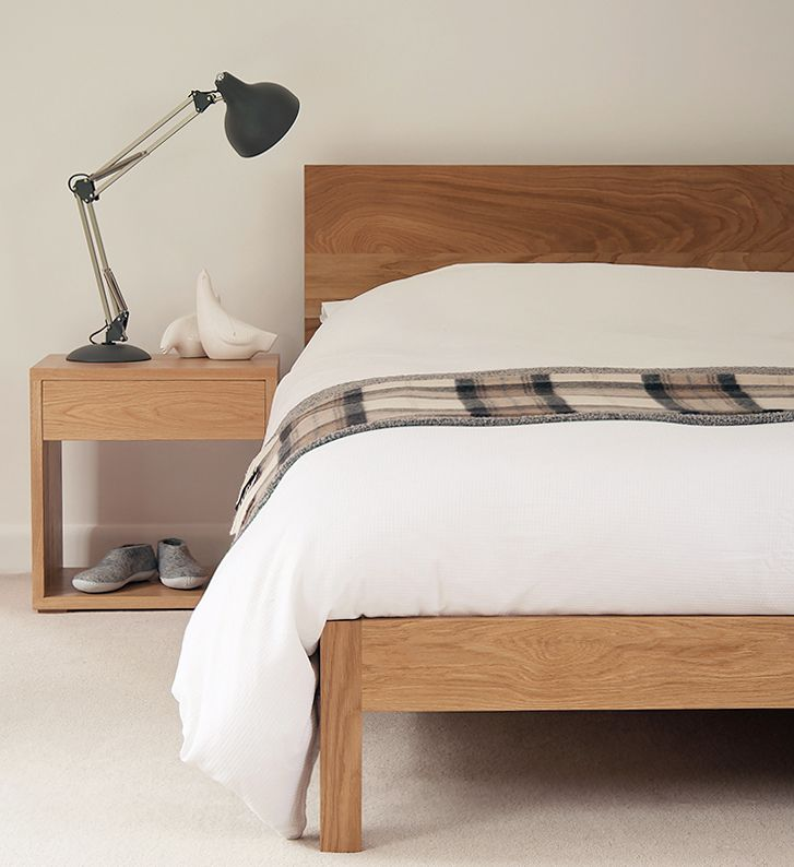 A solid oak Malabar bed and Cube bedside table. Both from Natural Bed Company. http://www.naturalbedcompany.co.uk/shop/classic-beds/malabar-wooden-bed/