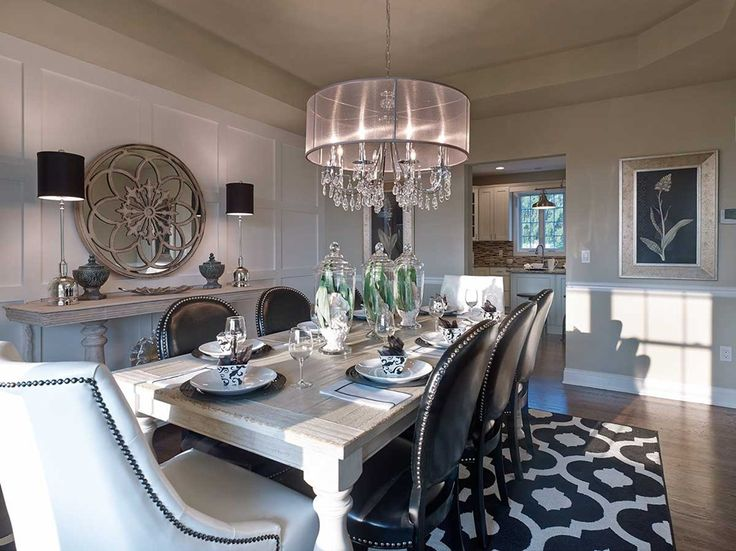 A distinctive stone accent wall defines a dining room in a stunning new  home built by Lafferty Communities  The Oakwood Shores community  Manteca. A distinctive stone accent wall defines a dining room in a