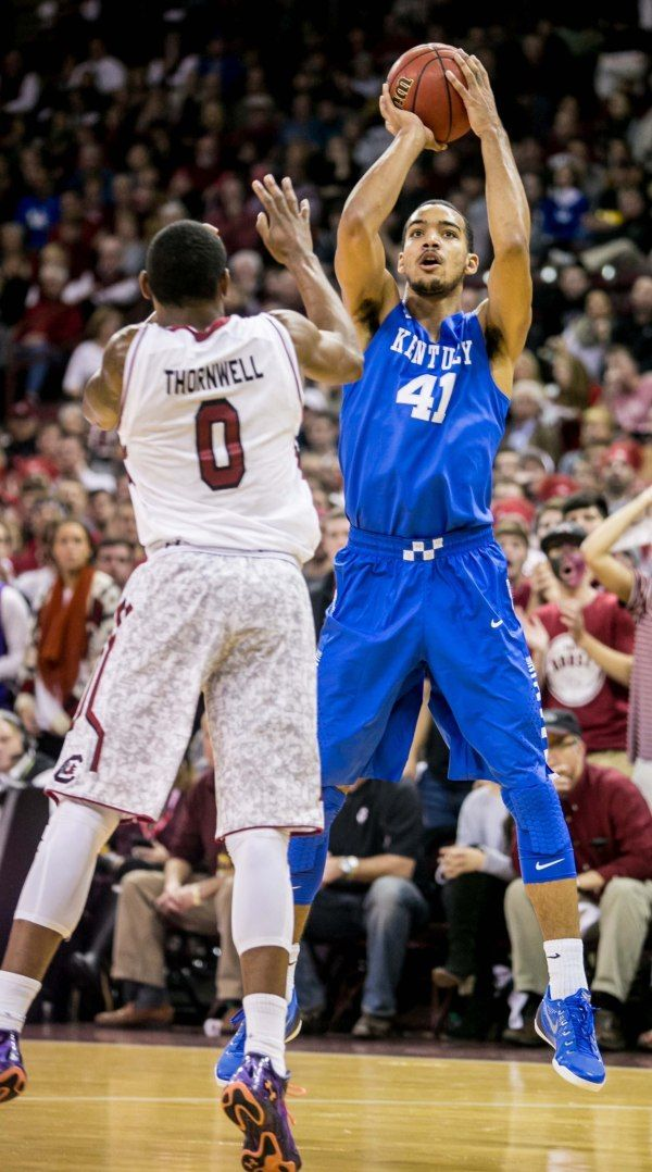 Wildcats forward Trey Lyles (41) shoots over South Carolina Gamecocks guard Sindarius Thornwell (0).