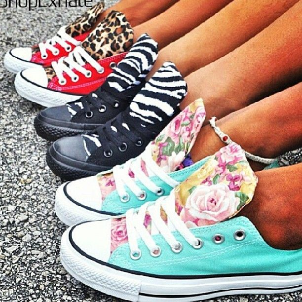I could totally do this! Just sew/glue a piece of fabric to the tongue of converse. Cute!