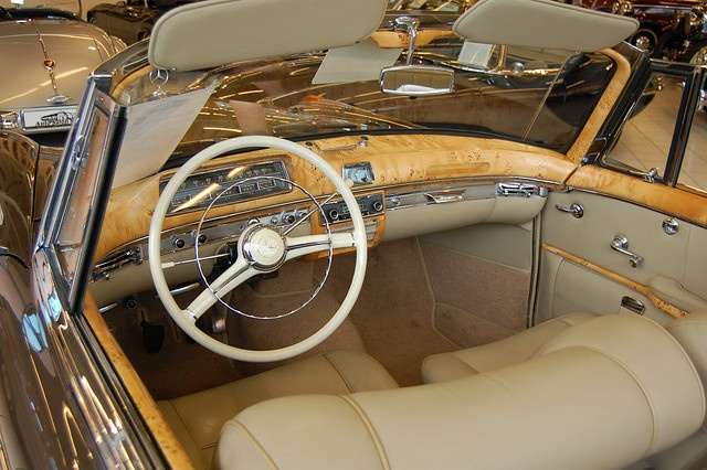 Interior of Mercedes Benz 220S at Auto Salon Singen, Germany. One of those rare cases where wood looks good in a car.