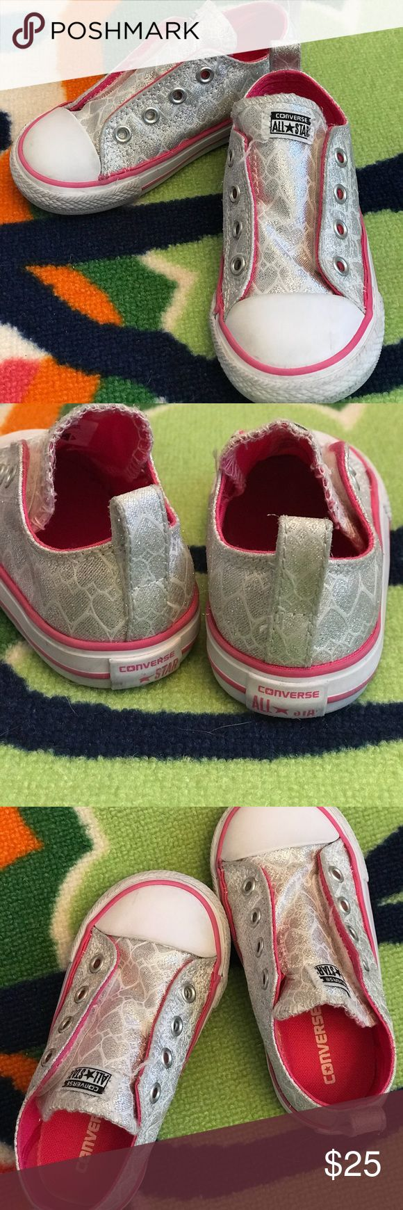 Converse All-Star Girls Tennis shoes- Size 7 Shiny Silver material with heart pattern in white  VERY gently worn- no wear on soles (inside or out) Only sign of wear is on front bottom/ back bottom (see pic) Velcro/ Elastic open (no laces)  As with all my listings, you're assured items come from a smoke-free home and are sanitized to the nest of my ability.  🤗All reasonable offers welcomed!🤗 Converse Shoes Sneakers