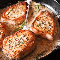 Pork chops in creamy white wine sauce are cooked in the juice of a fresh lemon, garlic and thyme. Juicy & packed with flavor, they are ready in 30 minutes!