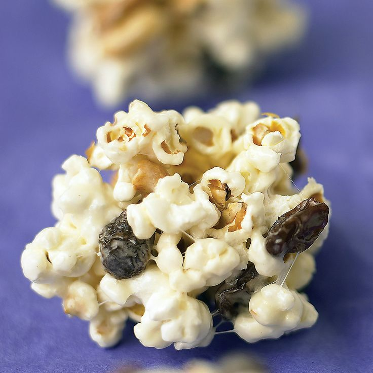 For popping kernels, follow instructions on package, or use 12 cups plain popped microwave popcorn (without salt or butter). Also, try substituting other types of dried fruit and nuts for the raisins and peanuts.