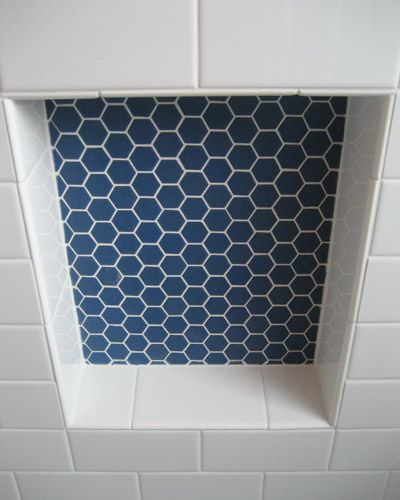 The niche is a deep blue hex tile. The balance is…