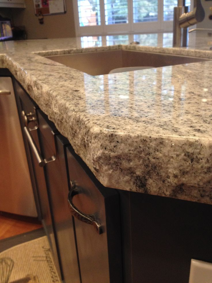 We love the rustic outdoorsy look with this double chisel edge granite counter top.  Nice part is you never have to worry about someone chipping it. So happy.