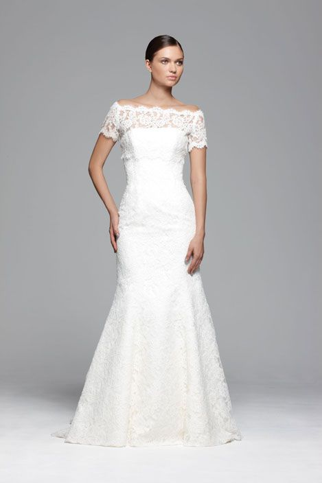 A strapless corded lace fishtail Stewart Parvin wedding dress with a straight neck line and a scalloped edged hem. Beautiful silk duchess satin covered glove buttons cover the zip at the back, with Anne jacket in matching lace.Stocked by www.paperswanbride.co.nz in Wellington, New Zealand