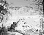 An allied rifleman draws a bead on an enemy target on hill at far right during attack on Chinese Communist troop positions in the Wonju area of Korea?s icebox front on Jan. 13, 1951. United Nations troops had routed strong red forces on January 19, and had stormed back into Wonju in the face of an expected enemy offensive. (AP Photo/JM)