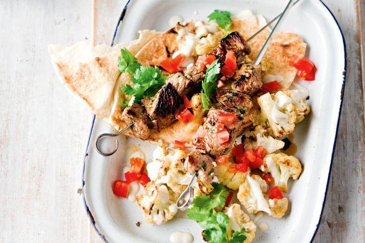 Cumin-spiced beef skewers with tahini cauliflower