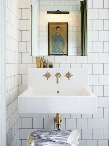 Wall mounted sink and brass plumbing fixtures. Fabulous!                                                                                                                                                                                 More