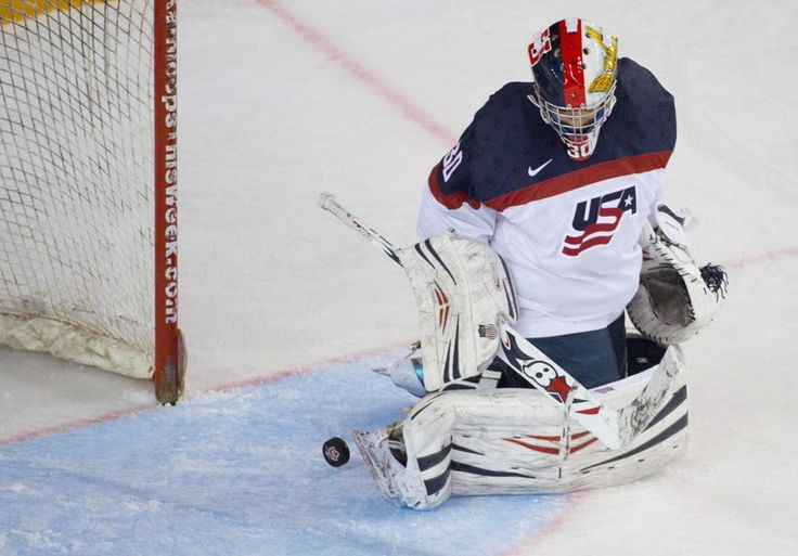 A shot from Canada's Jennifer Wakefield goes past U.S. goaltender Molly Schaus during the second period of the title game of the Four Nations Cup women's hockey tournament, Saturday, Nov. 8, 2014, in Kamloops, British Columbia. (AP Photo/The Canadian Press, Jonathan Hayward)