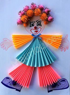 Em folhas de papel A4 de várias cores (rosa, azul e laranja) recortámos semi-círculos que dobrámos em forma de leque de forma a represent...