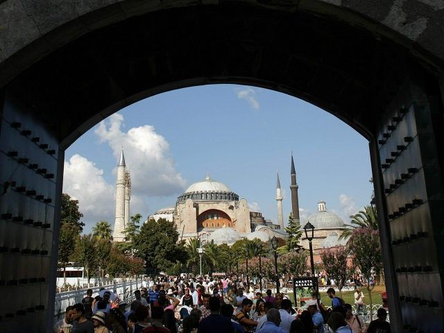 Ok...and at Christmas and Easter (especially Easter) the mosques will open to the christians, right?  Local and foreign visitors, with the Byzantine-era monument of Hagia Sophia in the background, stroll at Sultanahmet square in Istanbul August 23, 2013. REUTERS/MURAD SEZER