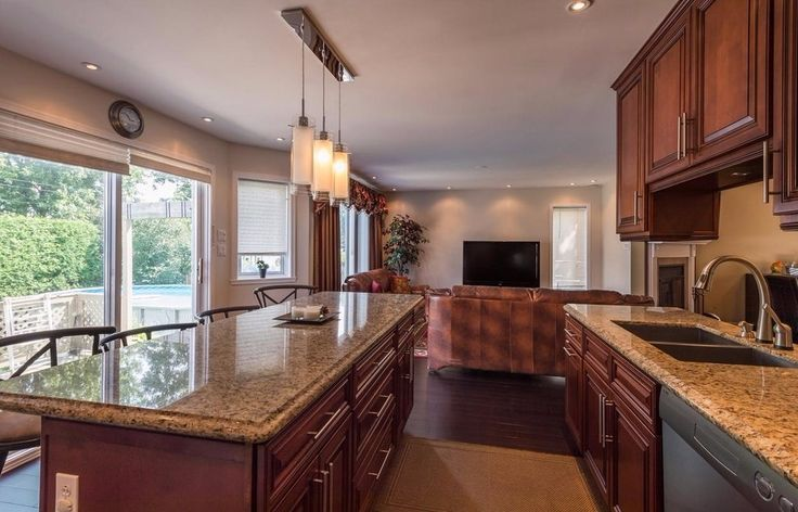 Roomy contemporary brown kitchen! Say good-bye to cramped cooking... Knock down a wall and extend your kitchen! Build your dream kitchen with SCD Design & Construction!