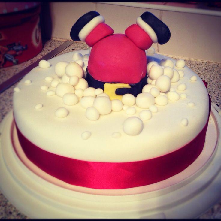 Santa stuck in Xmas cake